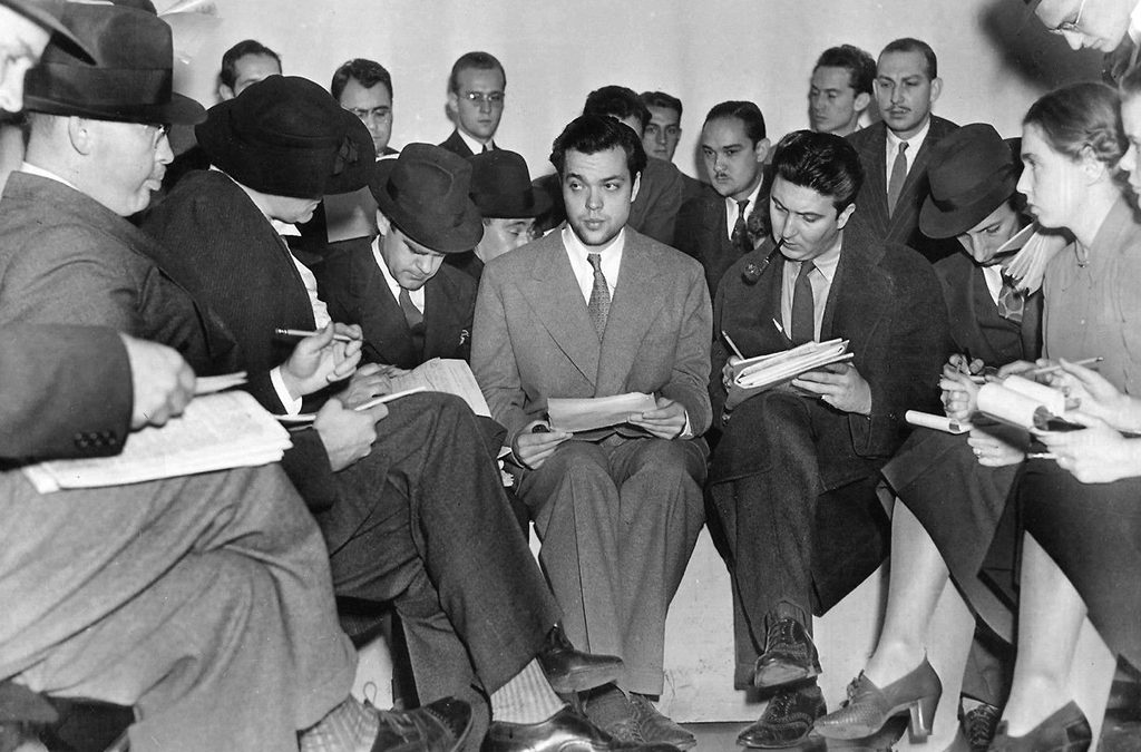 1938: Orson Welles answers questions from reporters the day after his radio drama The War of the Worlds.